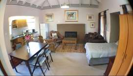 Fully Furnished Garden Cottage with wood burning Fireplace