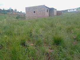 Land with unfinished house
