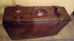 Skórzana walizka na kółkach