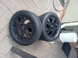 """14""""Mags 4x100 with new 165/65/14 Tyres"""