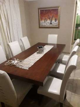 8 piece Bradlows  dining suit with a side table