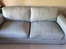two seater leather couch grey. Immaculate condition