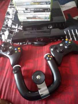 XBox 360, steering wheel , 2 controller , kinect sensor and games