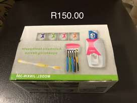 Toothbrush and toothpaste holders