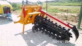 Tractor operated chain trencher implement