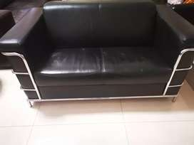 Two seater black leather couch