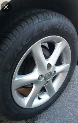 "Alloy 15"" rims and tyres"