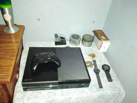 Xbox One console , with two controllers