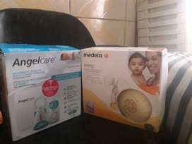 Angelcare AC601 baby monitor and a Medela swing electric breast pump.