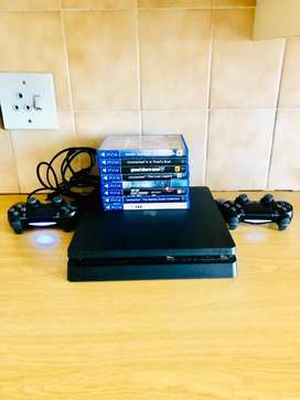 Sony Playstation 4 1TB  (Hardly being used)