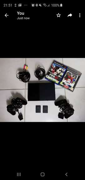 PLAYSTATION 2 with two games and controllers