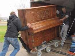 Услуги грузчиков,перевозка мебели,пианино.Переезды,грузоперевозки Киев