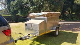 It's a camping trailer with additional tent.