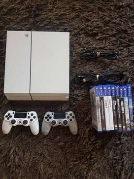 White Playstation 4, 1 Tb storage, 2 Remotes, 9 Games
