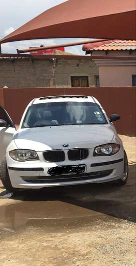 BMW 1 Series 2008 model white in color 118i manual