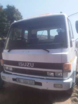 Isuzu roll back tow truck white