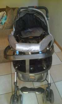 Image of baby pram with car seat