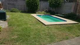 Two bedroom flat with pool and double carport
