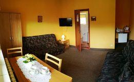 Pokoje gościnne z łazienkami oraz balkonami w centrum Miedzybrodzia