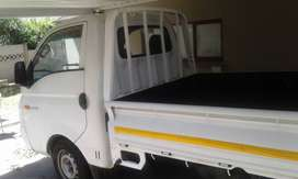 Hyundai h100 bakkie and trailer with driver for hire
