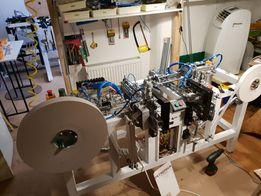 Автомат, производящий папиросные гильзы.