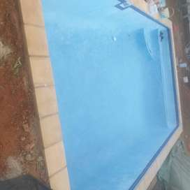 Swimming pool and thatch lapas installation