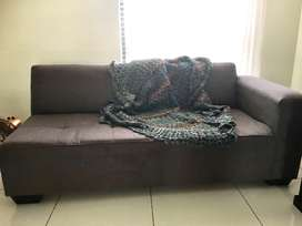 charcoal L shape couch.