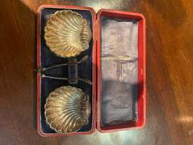 Silver shell salts dishes with spoons