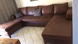 Brown U shape couches