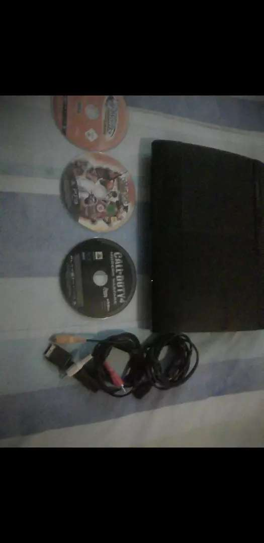 PlayStation 3 with three games 0