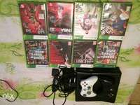 Image of Xbox 360 console with eight games