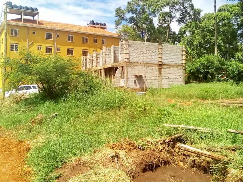 Plot for sale in kyaliwajjala town on the main road seated on 14 de 0