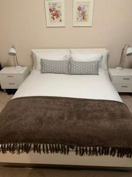 Queen sized bed with Simmons mattress and side cupboards