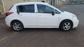 Selling Nissan tida car 2011 moder white color with perfect condition