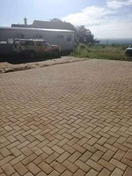 Tarring, paving, concrete and also returning walls