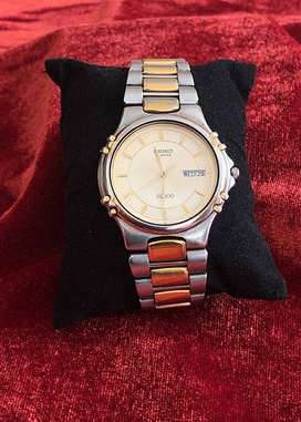 VINTAGE SEIKO SQ100, QUARTZ MEN'S WATCH, TWO TONE DAY-DATE, WORKING
