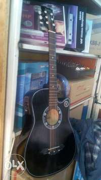 Medium semi acoustic guitar 0
