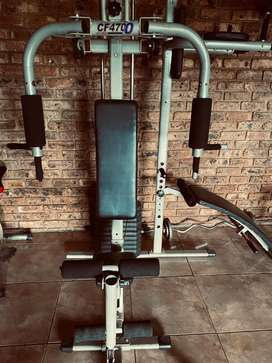 Complete home gym with fitness bicycle