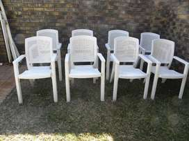 8 Plastic Patio chairs