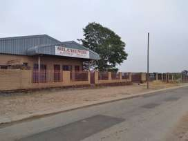 Commercial Site with complete building for Sale