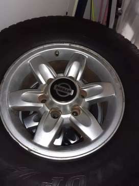 Dunlop tyres and Nissan hardbody rims for sale