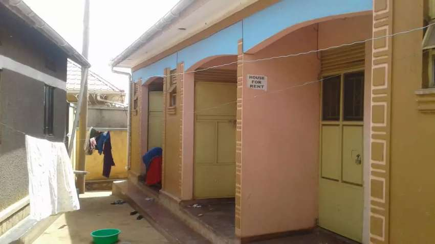 Three spacious single rooms rentals with stores on sale in nansana 0