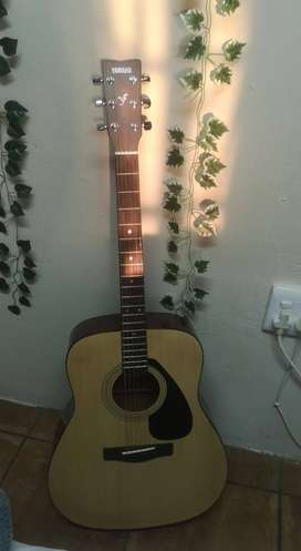 Yamaha F310 acoustic guitar once used