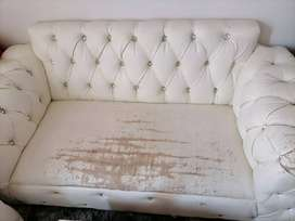 White leather couches need a little bit of touch up.