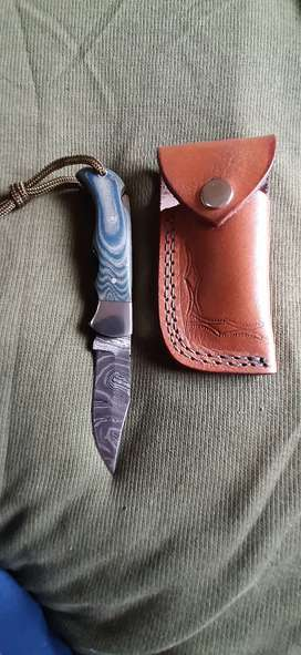 Hand made Damascus steel pocket knive with leather pouch