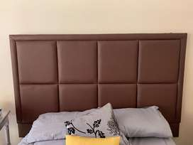 Brown double bed headboard