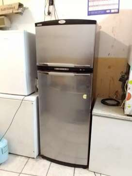 Whirlpool fridge working condition clean and neat