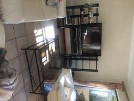 I'm selling a plasma tv stand in black with 4 glass shelves
