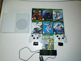 Xbox one s series 2 controllers a battery charging pack and 7 games