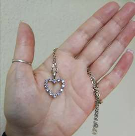 Silver necklace with 12 Tanzanite stones in a heart shaped Pendant